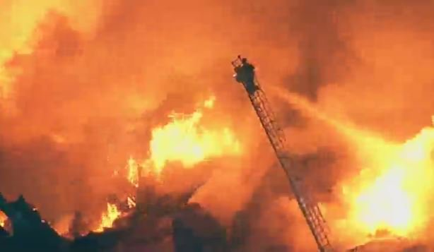 massive fire in Oakland, CA. Firefighters actively searching for possi...