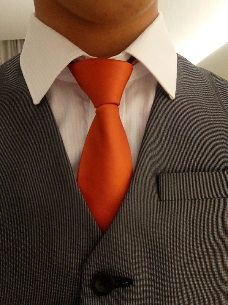 I am obsessed with this orange tie. It's not orange pants, but it's a step closer.