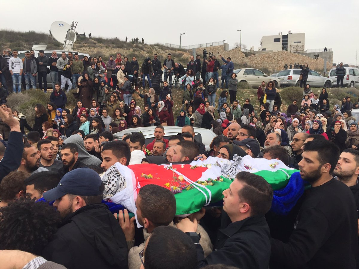 Thousands of Palestinians attended the funeral of Bassel al-Araj in al-Walajah. He was killed by Israeli forces over a week ago