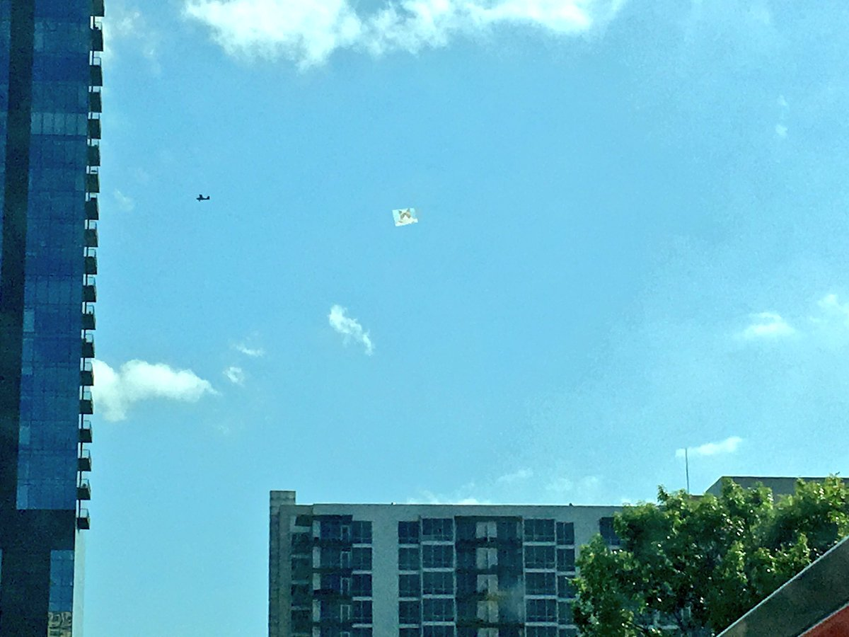 Look! It\'s a picture of #GrumpyCat being towed by a plane! #TheMostAustinThingEver #SXSW #KeepAustinWeird