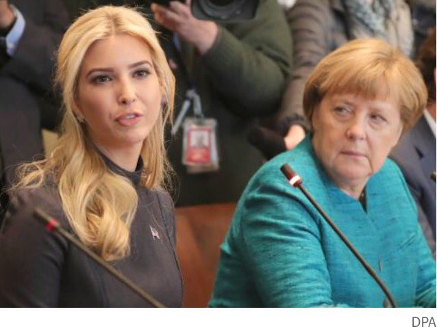 Merkel: Why is a Handbag Designer at this Meeting?