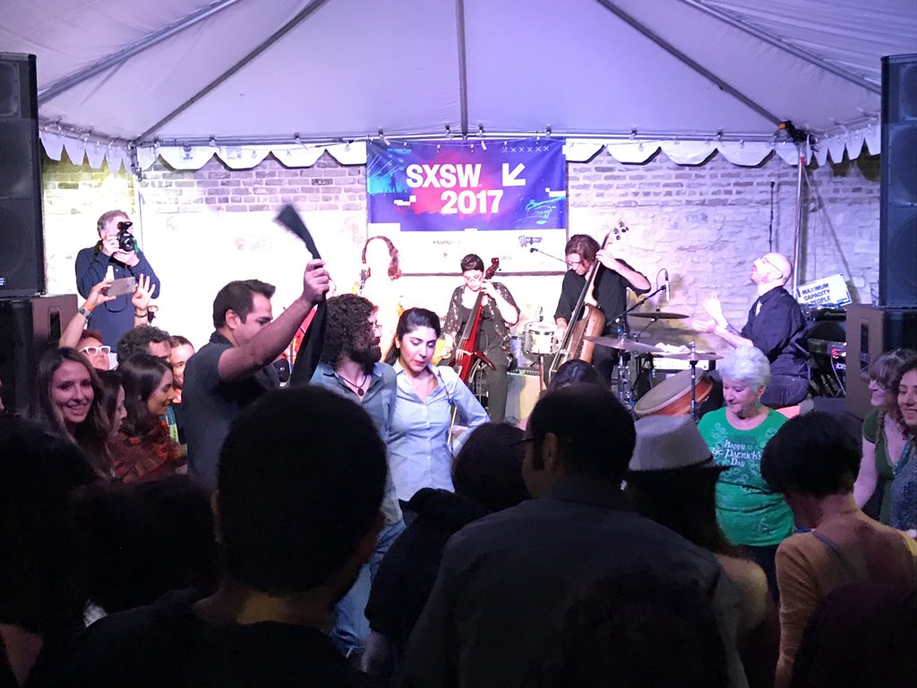 Mamak Khadem Ensemble from #Iran plays a Kurdish song, asking everyone to hold hands in a line dance as a sign of unity. #MusicUnites #SXSW https://t.co/k2Xo1r5rH8