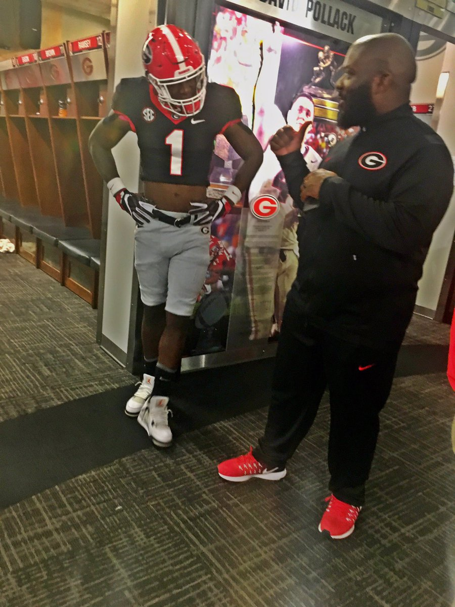 Caleb Tannor (left) with Georgia d-line coach Tray Scott (right) (Photo from Caleb Tannor/Twitter)