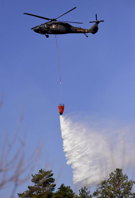 National Guard choppers now making water drops on #SunshineFire in Boulder
