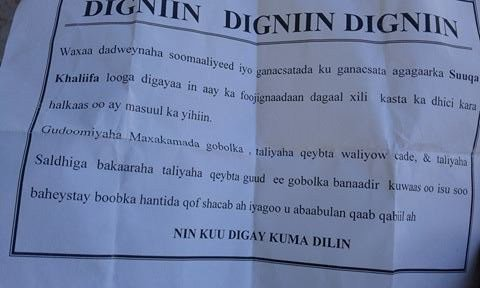 "Warning letters scattered in Bakara market, the main commercial area of the city. Letters says ""high alert. Somalia"
