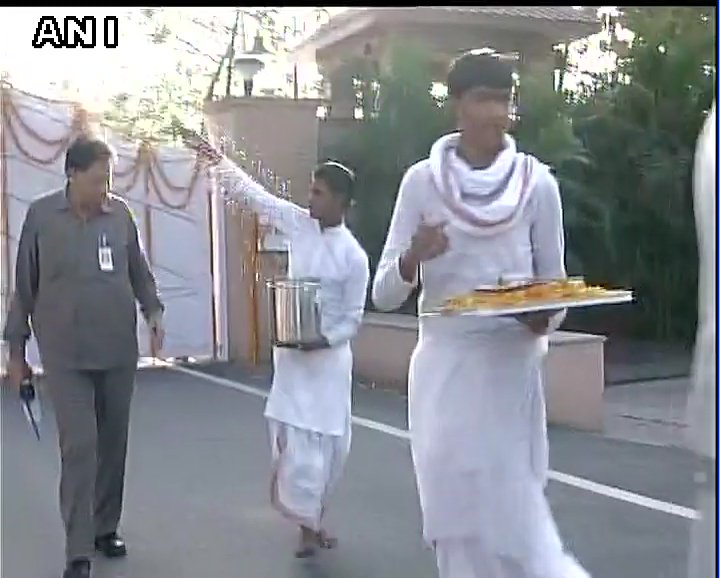 Uttar Pradesh: Purifying rituals performed outside Chief Minister Yogi Adityanath's residence at 5 Kalidas Marg, Lucknow