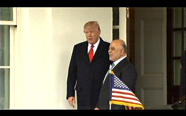 Pres Trump welcomes Iraqi PM Haider al-Abadi on arrival at West Wing portico.