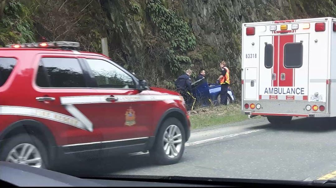 Vehicle in the ditch heading southbound near Goldstream. Emergency cre...