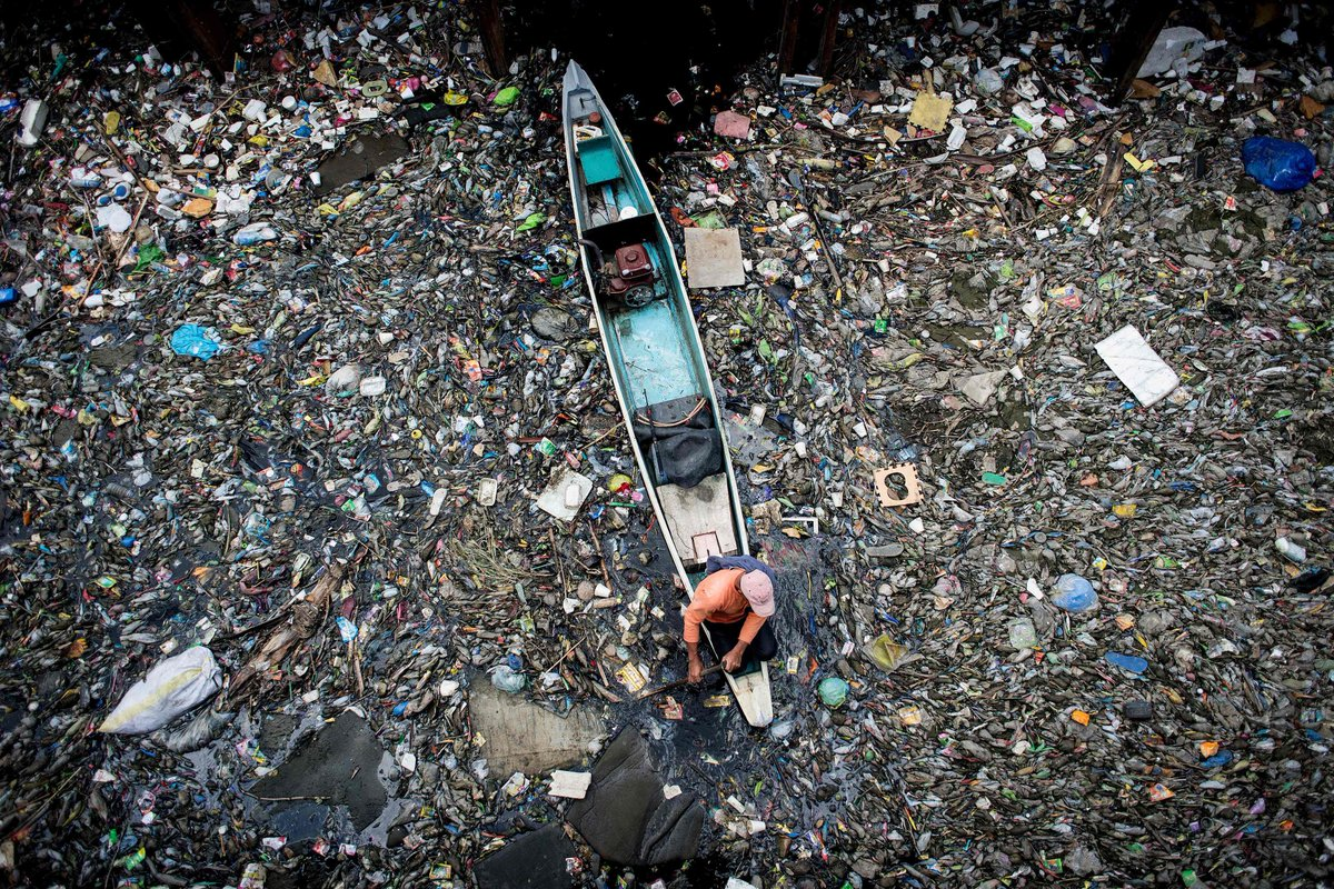Workers collect garbage Marilao river Bulacan north Manila Pictures