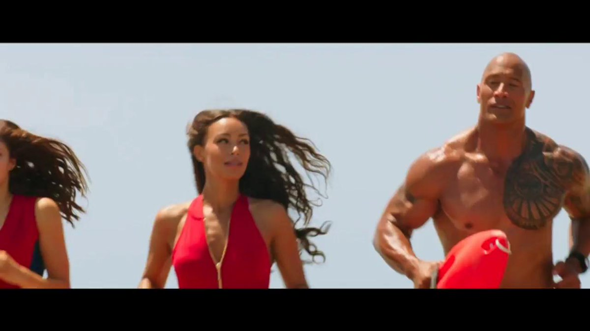Check out the new #Baywatch trailer. @ZacEfron and @TheRock can litera...