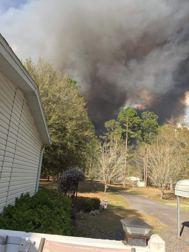 JUST IN: Images show HUGE smoke clouds approaching a house on  Country...