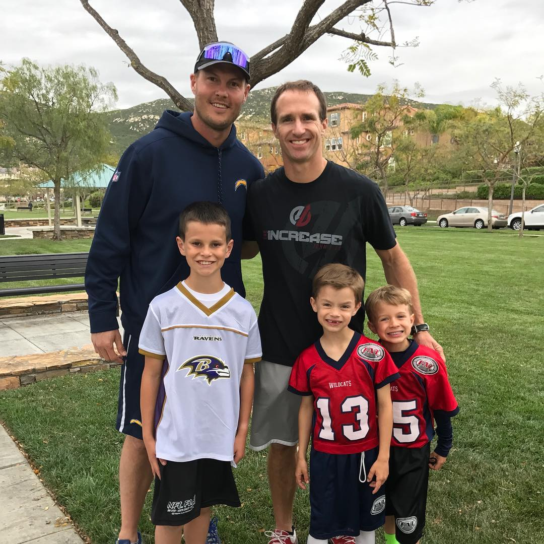 Life comes full circle as Philip Rivers and Drew Brees watch their son...