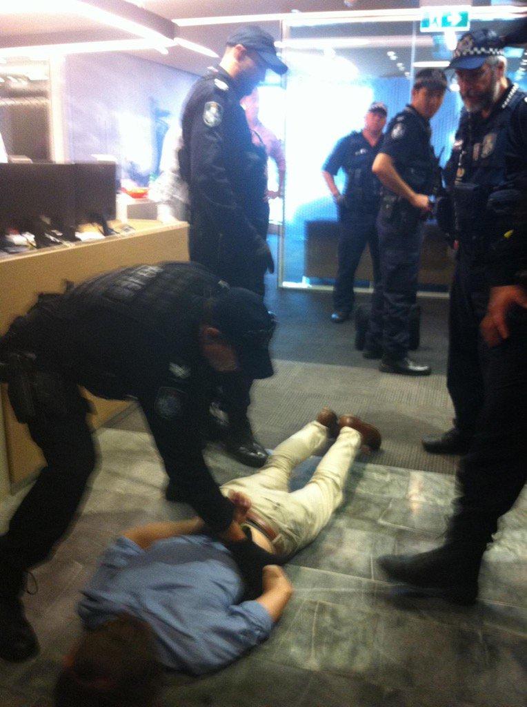 Peaceful protestors cuffed at Aurizon HQ #stopadani #nohandoutsforcoal https://t.co/TGdrW8v24N