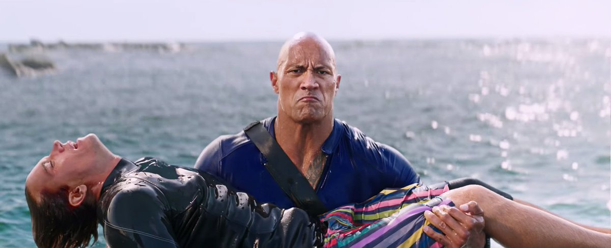 Watch Dwayne 'The Rock' Johnson and Zac Efron fight crime in the new #...