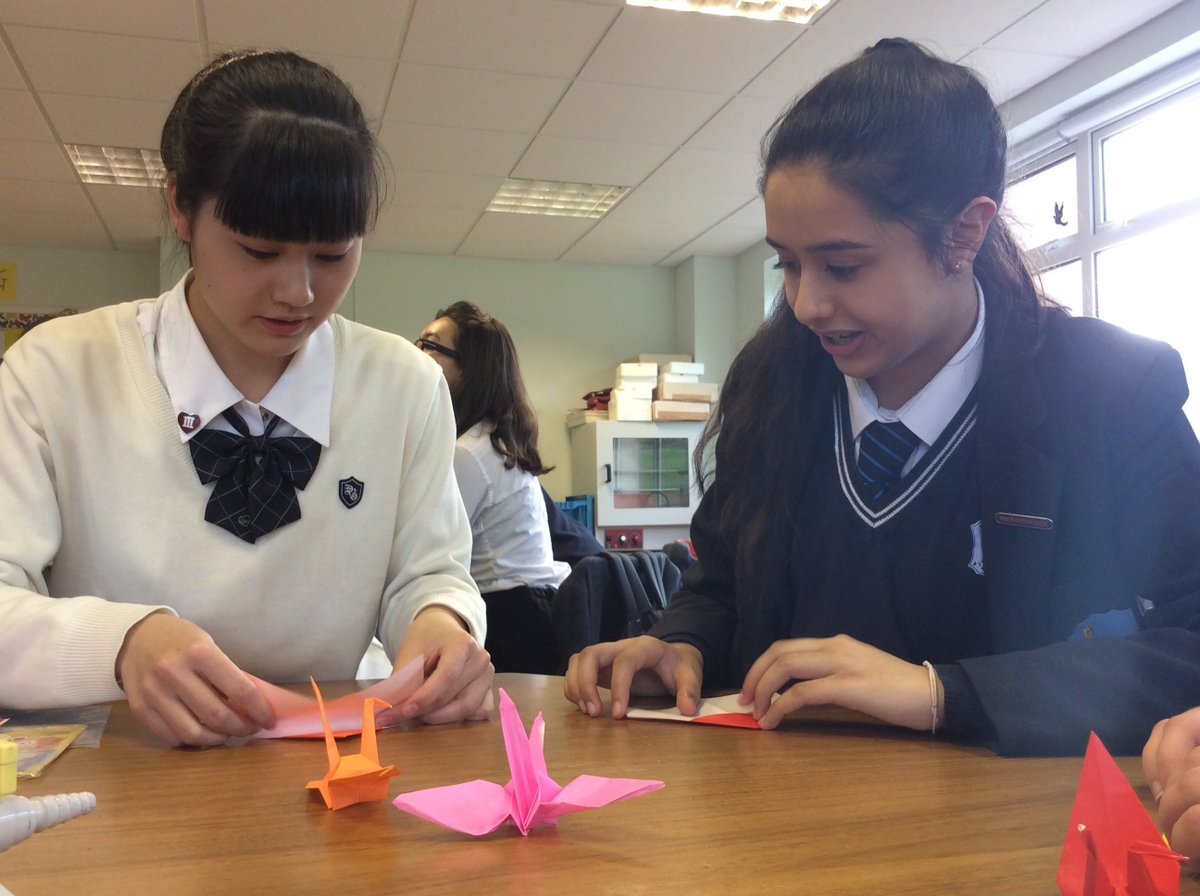 Being taught the art of origami by visiting Japanese students. Lovely...