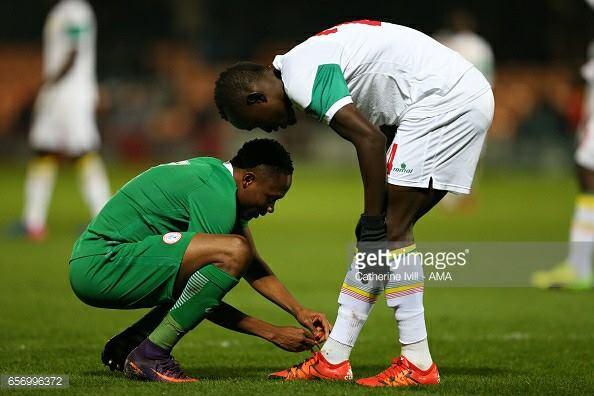 Ahmed Musa Tieing The Boots Of A Senegalese Player (Photo)