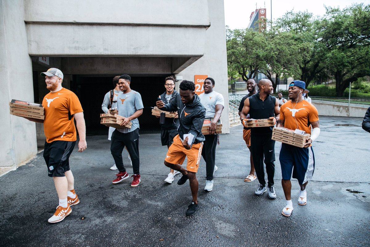 Image result for texas football team giving away pizza