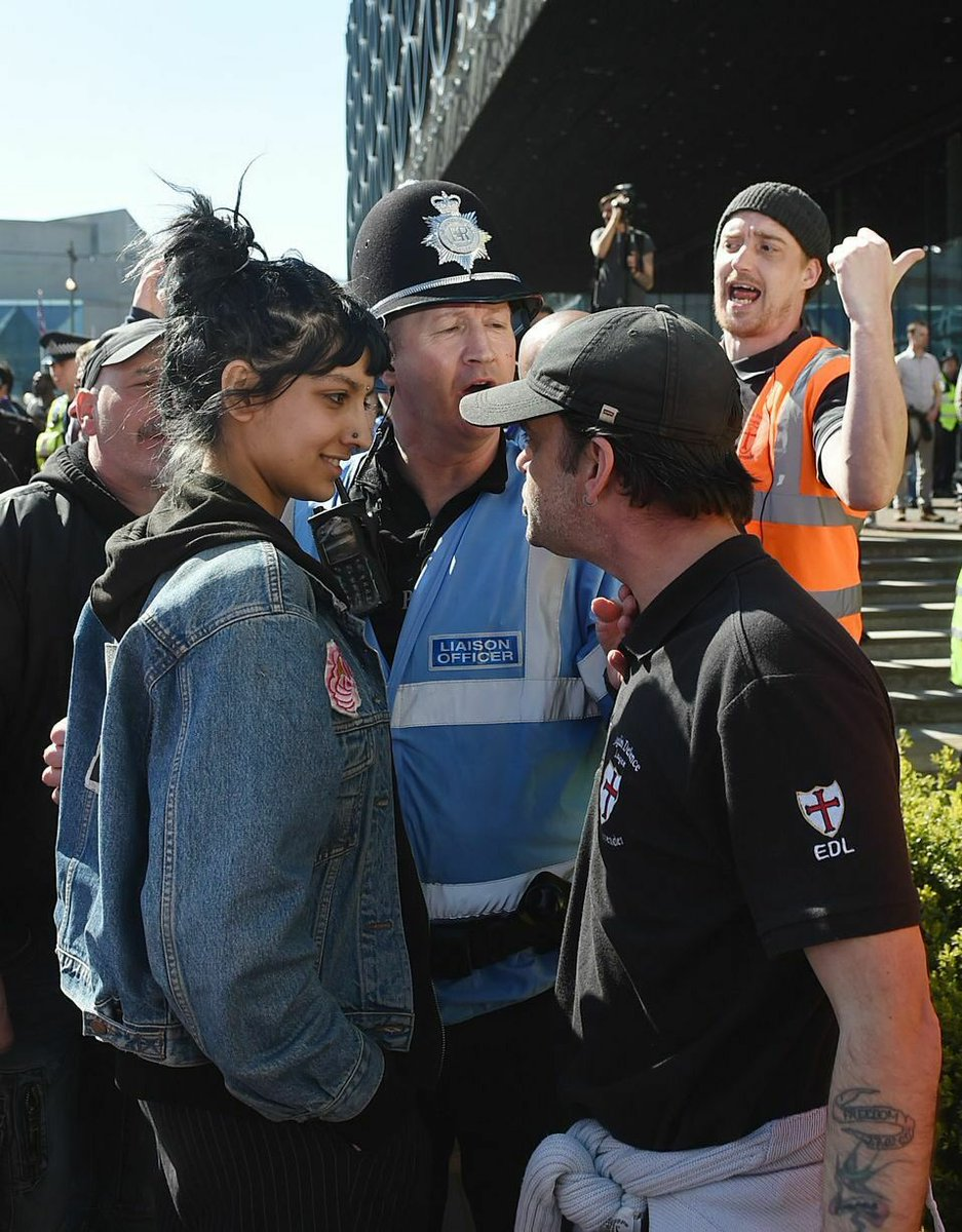 **PHOTO OF THE WEEK** Enraged EDL racist stared down by amused, contemptuous Asian woman.  #Birmingham   (via @AlexisTrust)