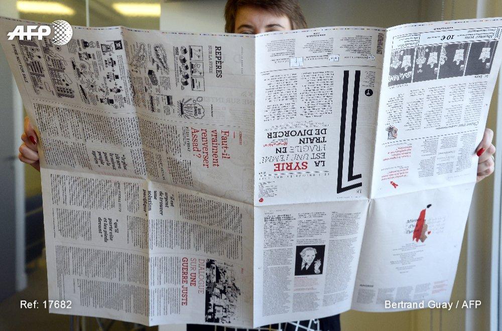 L&#39;hebdomadaire &quot;Le 1&quot; a réussi en trois ans à se créer une communauté de lecteurs #AFP  http:// u.afp.com/4gHQ  &nbsp;   @Le1hebdo<br>http://pic.twitter.com/7yXJhKydoD