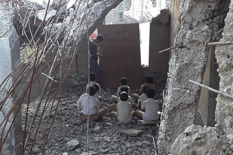 Red Cross caption: No books, no chairs, no safe place to learn: This is a classroom in #Yemen where 2 million children are out of school according to @UNICEF.