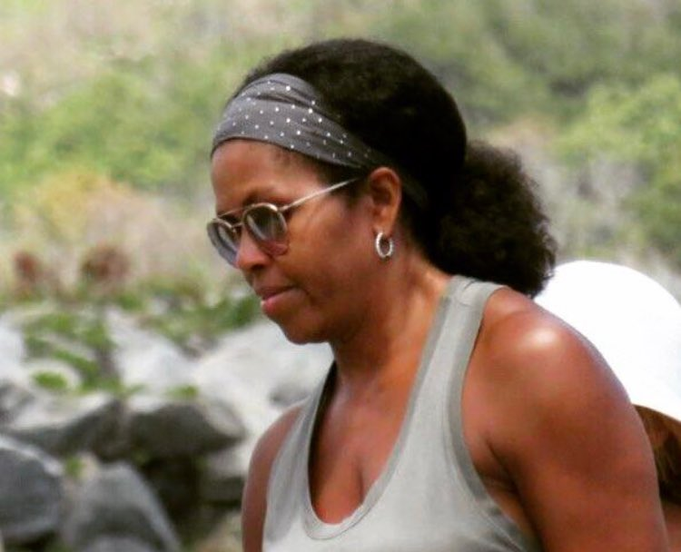 Michelle obama is now wearing her hair natural pics natural chick former first lady is spotted out wearing her hair completely natural we like her with curly hair pmusecretfo Images