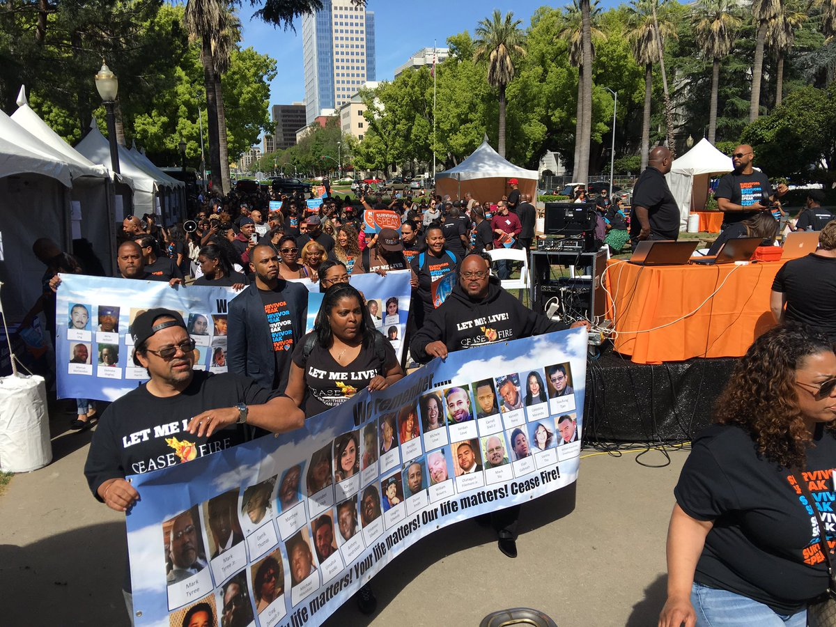 Crime survivors march toward the state Capitol. (Jazmine Ulloa / Los Angeles Times)