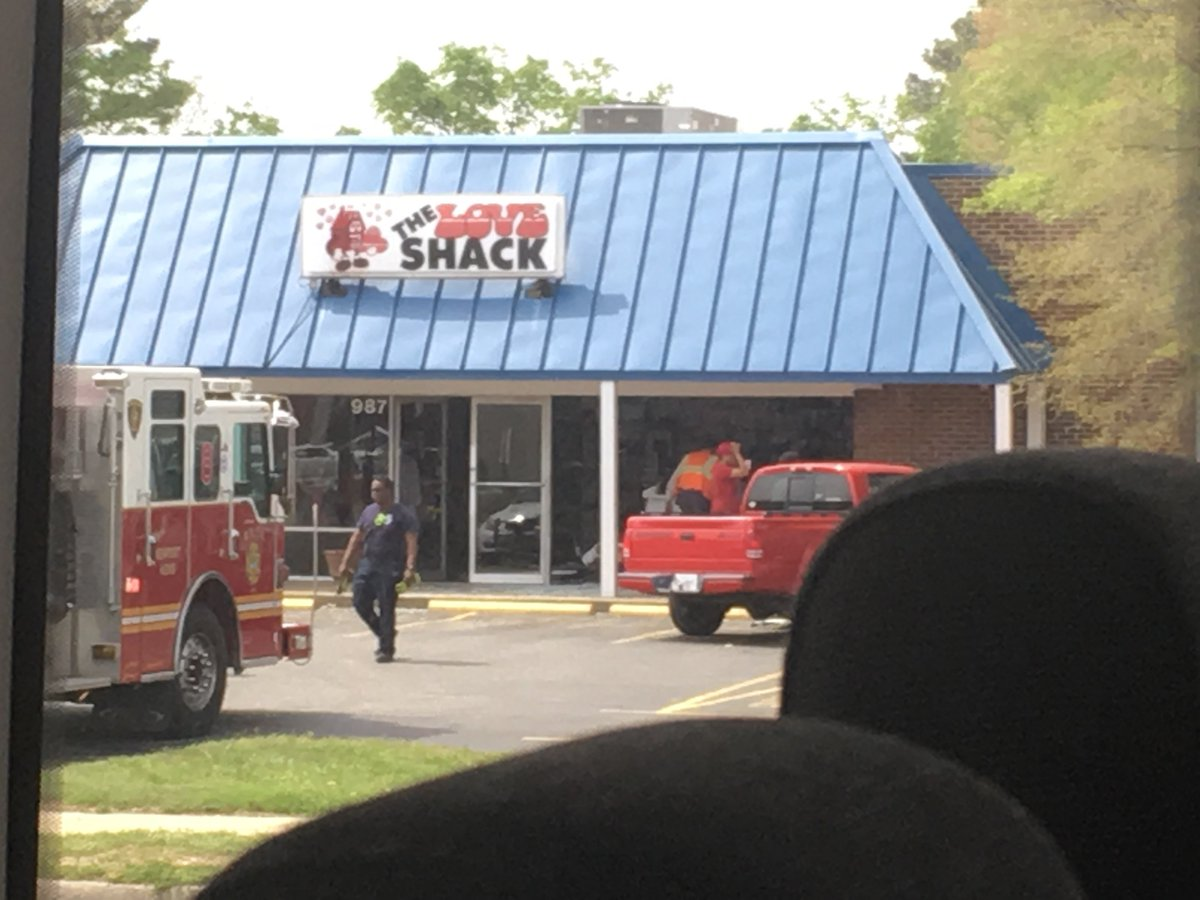 just in: car crashes into newport news adult entertainment store