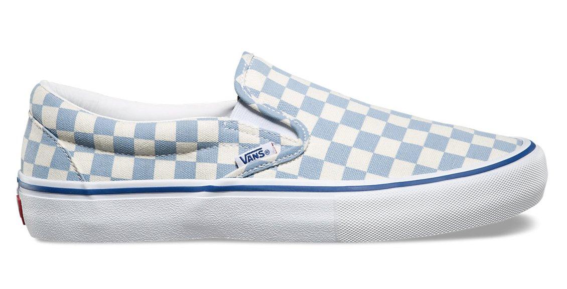 vans blue checkerboard slip ons