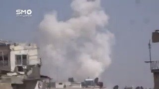 Smoke is rising as a result of heavy rocket fire on the neighborhood of Qaboon Damascus