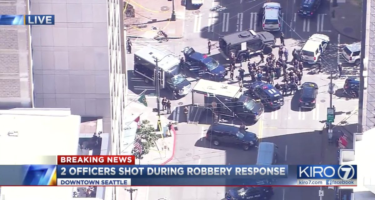Downtown Seattle shooting clearly related to a robbery attempt, search is on for a possible third suspect.