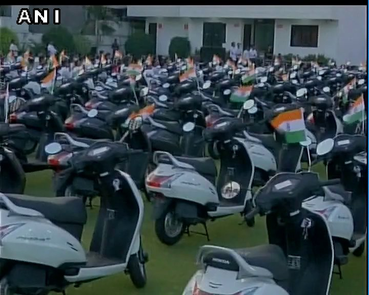 Surat (Gujarat): Diamond businessman Laxmidas Vekaria gifts a scooter each to his 125 employees as an increment