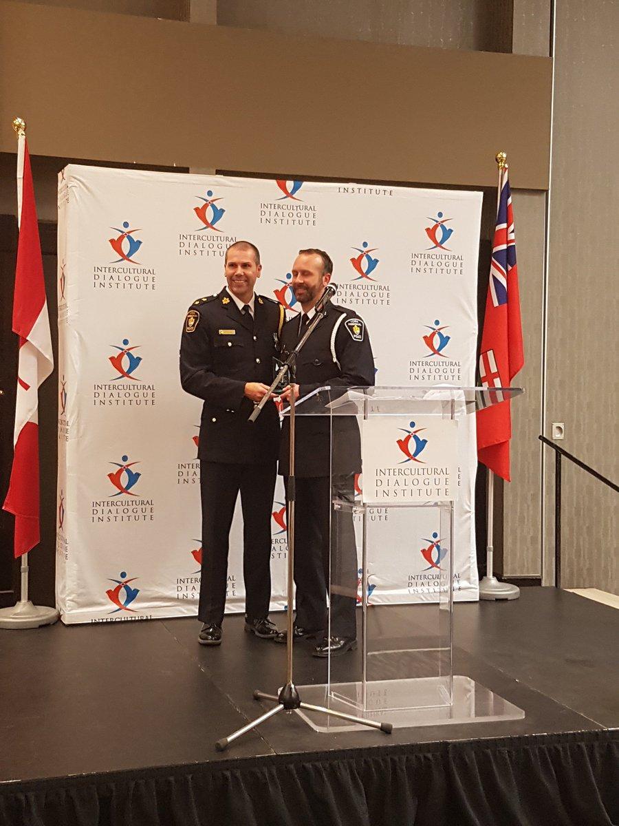 Inspector Paulo DaSilva of @YRP presents Public Heroes award to Brad W...