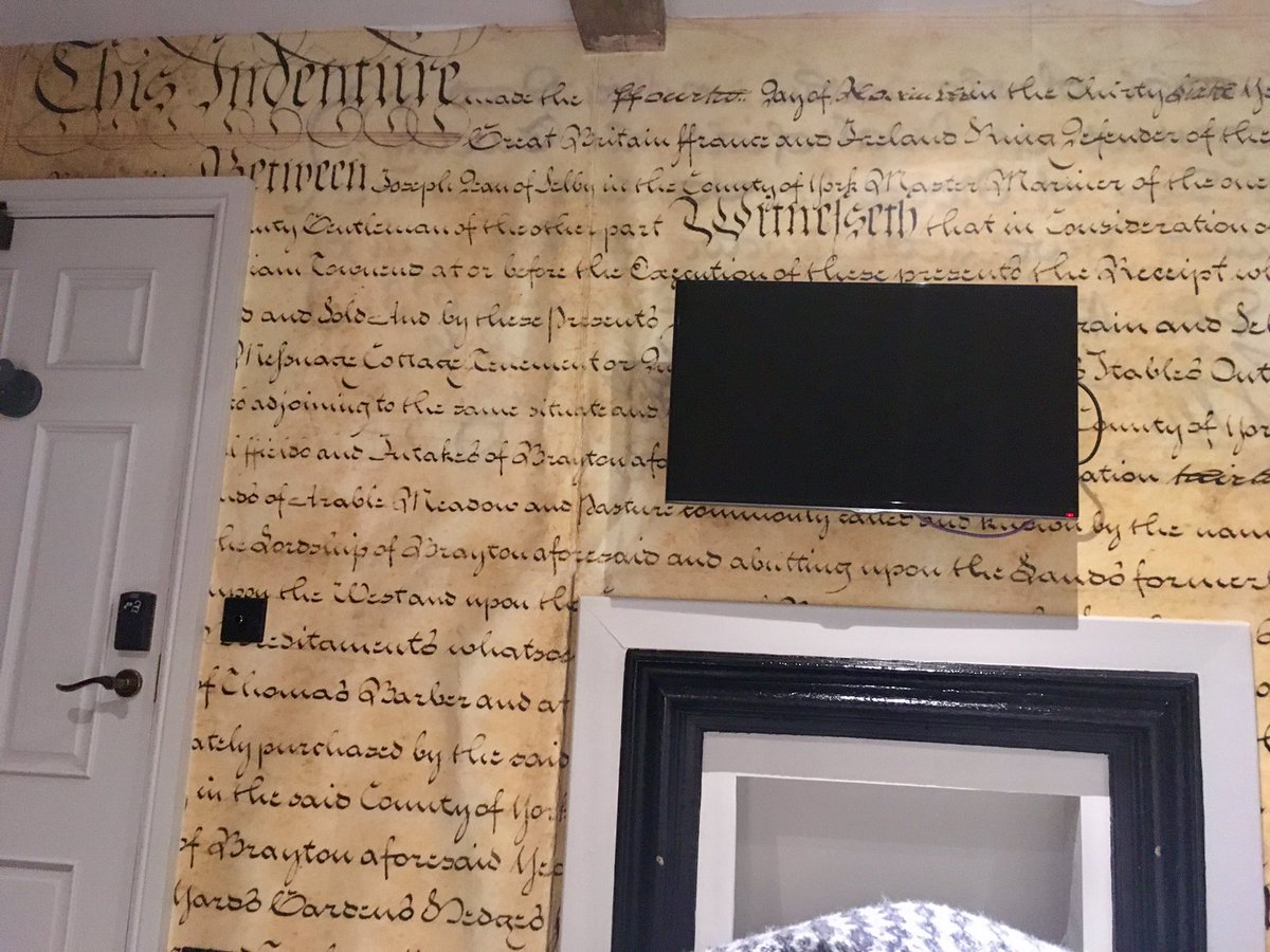 "Greg Jenner on Twitter: ""My hotel in York is where judges used to live - the wallpaper is an indenture contract from 1794, and there are manacles in the ..."