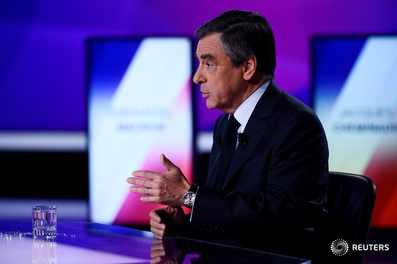 French presidential candidate Francois Fillon makes a statement after the Paris attack