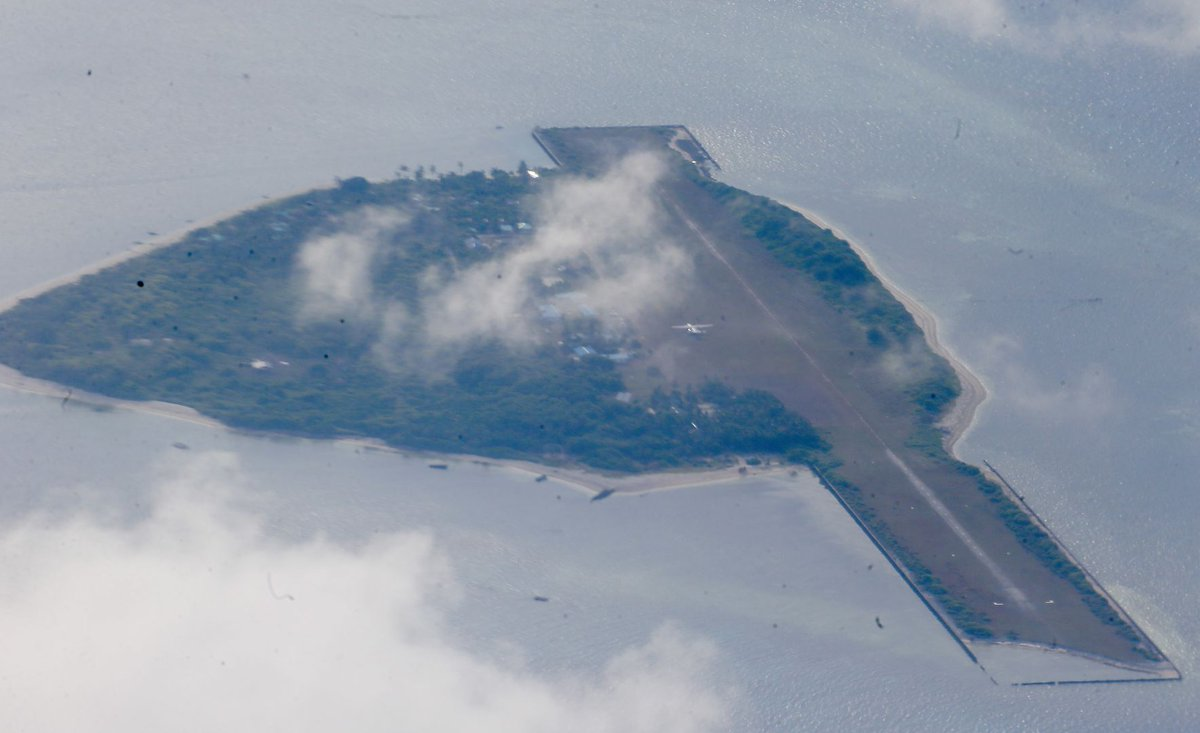 Philippine defence, military chiefs visit disputed South China Sea isle, to build facilities
