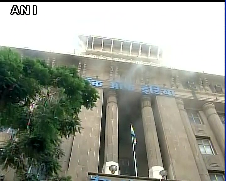 Visuals: Bank of India building catches fire in Mumbai's Fort area, fire fighting operations continue