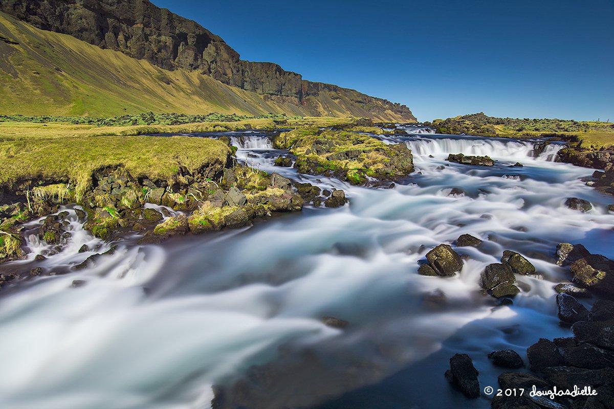 Waterfall along a stream, Iceland