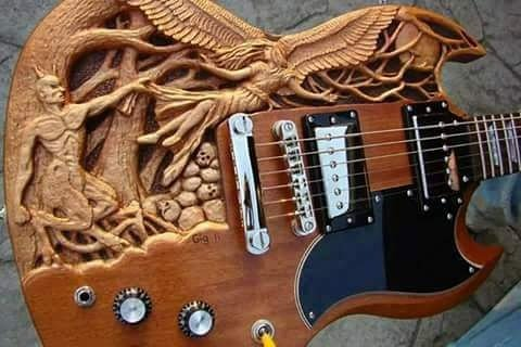 #HappySunday I had to #repost this magnificent piece of art! (guitar source unknown) #woodcarving #luthiers #Artists #visionaries #guitars<br>http://pic.twitter.com/uxtOiS6EJK