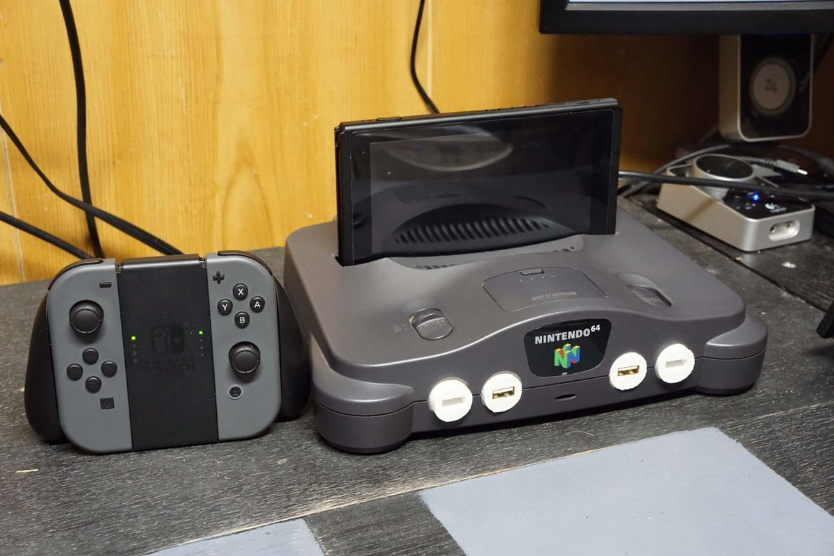Great idea but I'd never do it with mine: Reddit user tettzan777 turned a dead #Nintendo64 into a retro #NintendoSwitch dock! via @Radiobush