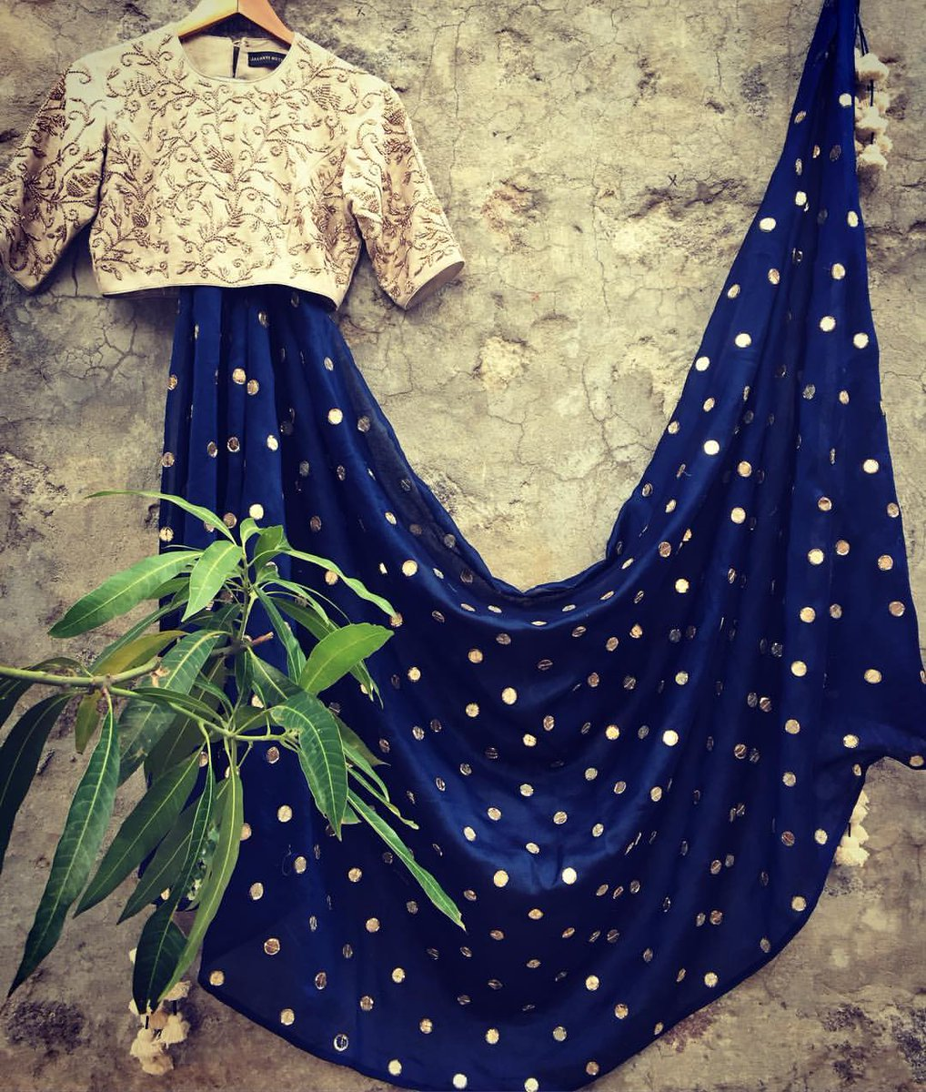 Breaking the subtlety of an ivory blouse with this deep indigo Saree!    jayanti reddy label  jayanti reddy