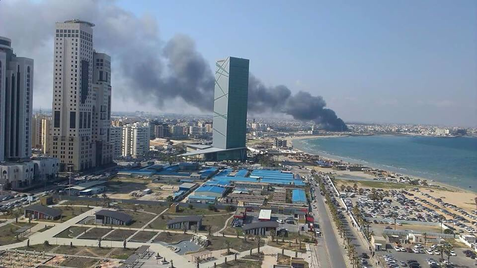 Huge smoke can be seen rising from Martyr Hall formally known as People Hall in Gergarish Tripoli. Reasons unknown. Libya