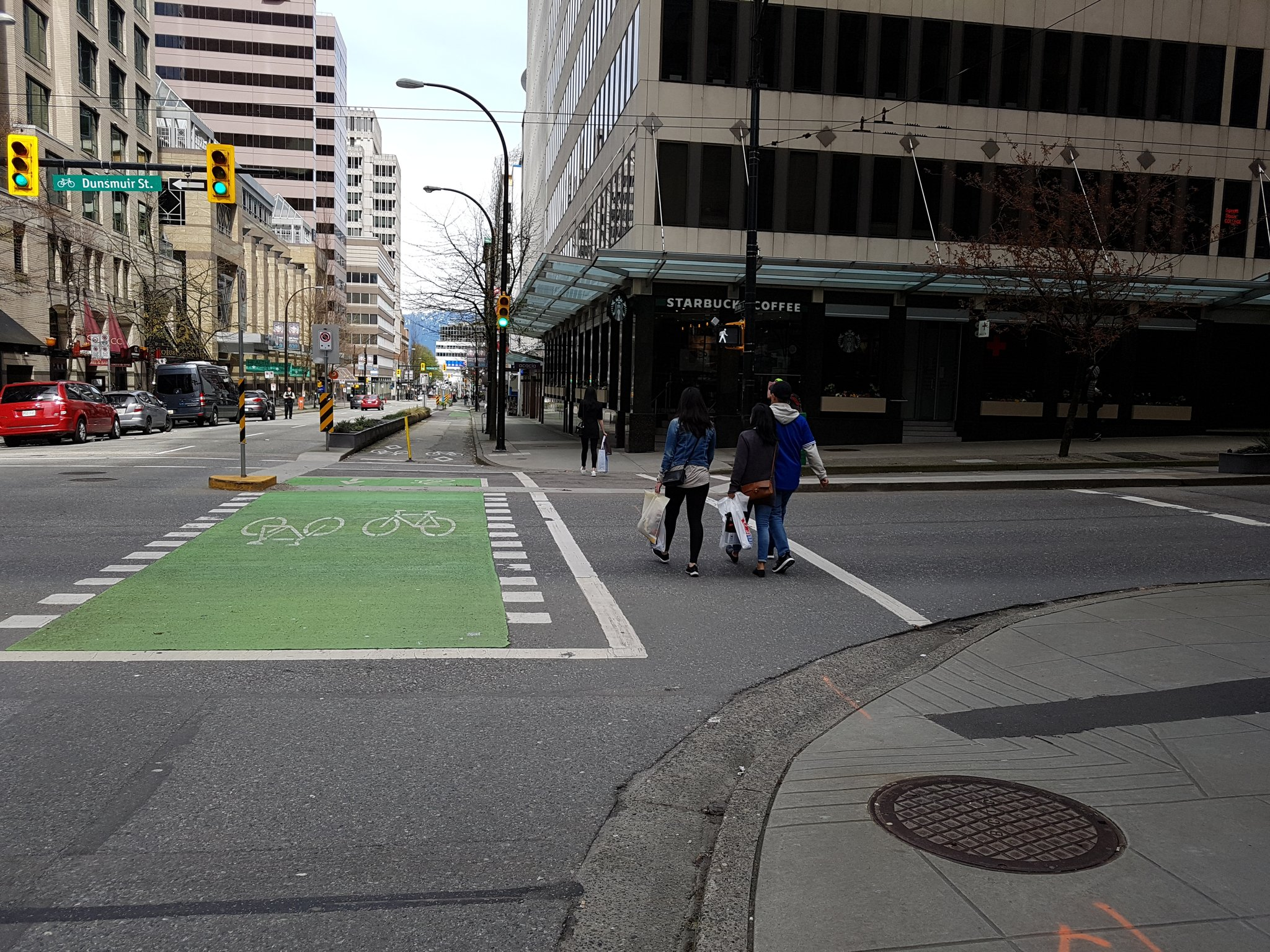 At intersection of Hornby & Dunsmuir lanes, new concrete added a few years ago to provide some protection for left turning bikes #yyjbike https://t.co/kWCgZGlF4y