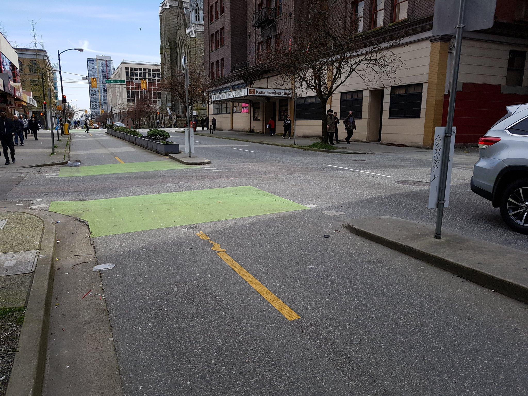 Note laneway crossing design. Concrete narrows entrance to slow vehicle drivers down. Contrast w Pandora w overly wide driveways #yyjbike https://t.co/idR0GcqJ0R