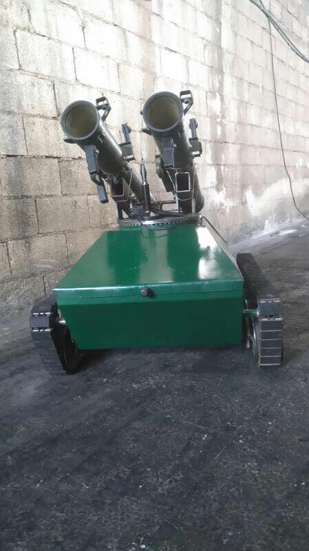 Syrian pro-government MP sharing pics of robot mounted with rocket launchers