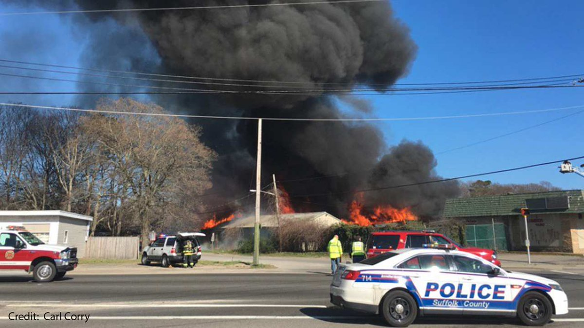 Fire burning at lumber yard in Mastic Beach, Suffolk County