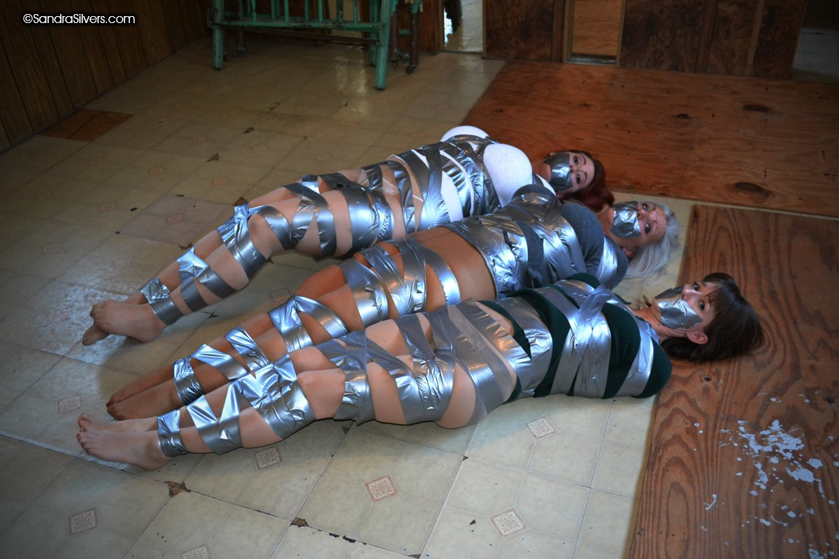 Mummified in silver duct tape 4