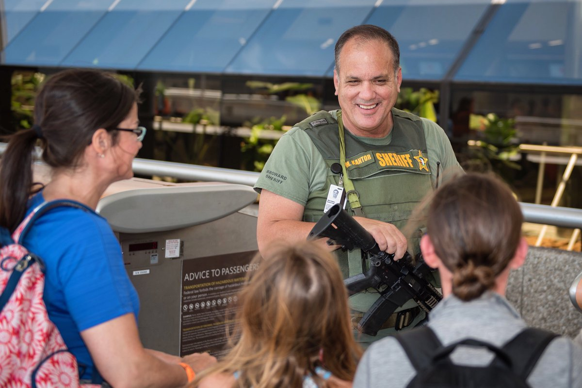 A #BSO deputy talks with a family before their flight at the @FLLFlyer,  which hosts approximately 25 million passengers each year. .    <br>http://pic.twitter.com/wpn0Y0sMe4