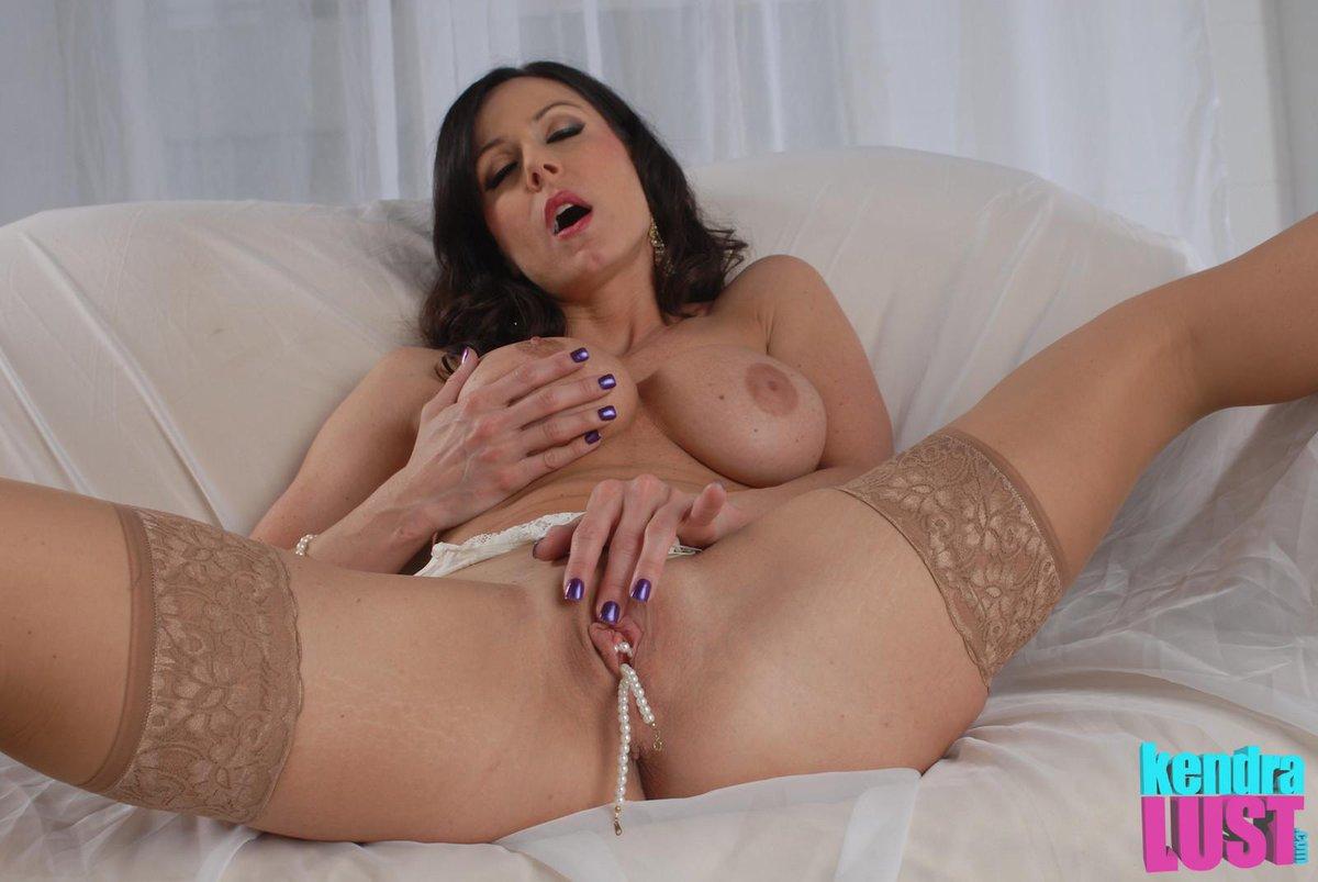 Brunette milf masturbating in stockings on gotporn