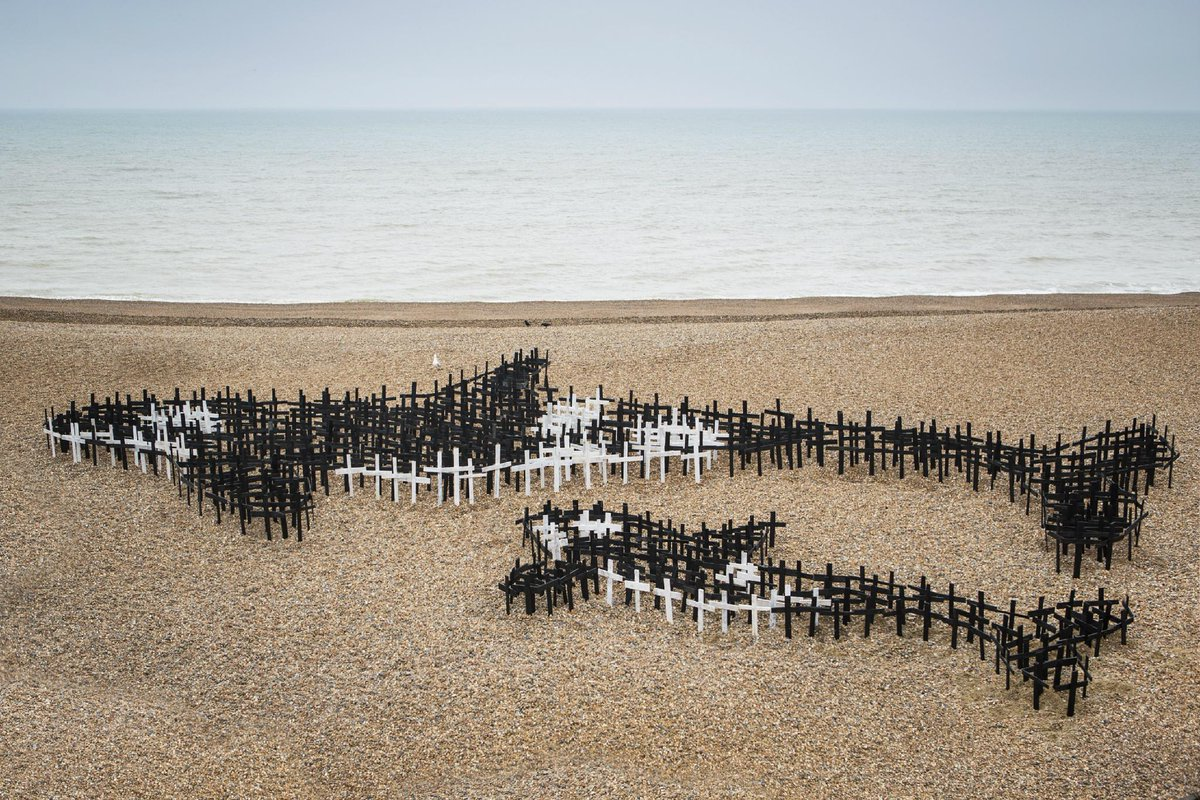 art installation 4 WhaleFest 'the whale grave yard'.  crosses symbolise whales & dolphins that have died in captivity http://t.co/pmYzr7a8w6
