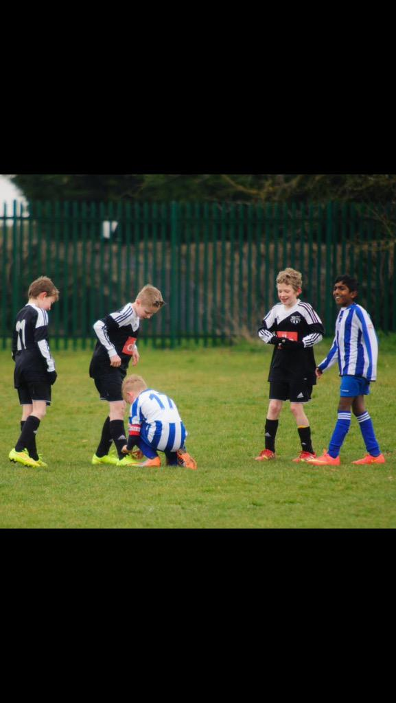 Try not to get carried away thinking kid's football is about winning trophies, this photo is EXACTLY what it's about. http://t.co/00hUTmo69r
